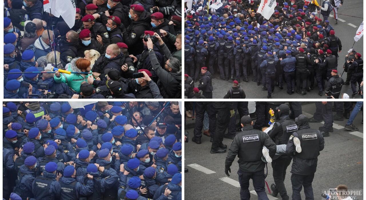 Выносят за руки и за ноги: протесты под Радой переросли в столкновения (фото, видео)