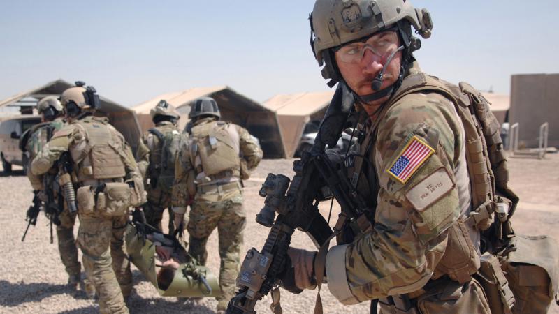 США специально оставили группировку своих войск на севере страны, где доминируют курды, с тем, чтобы защитить их и смягчить позицию Асада на швейцарских переговорах